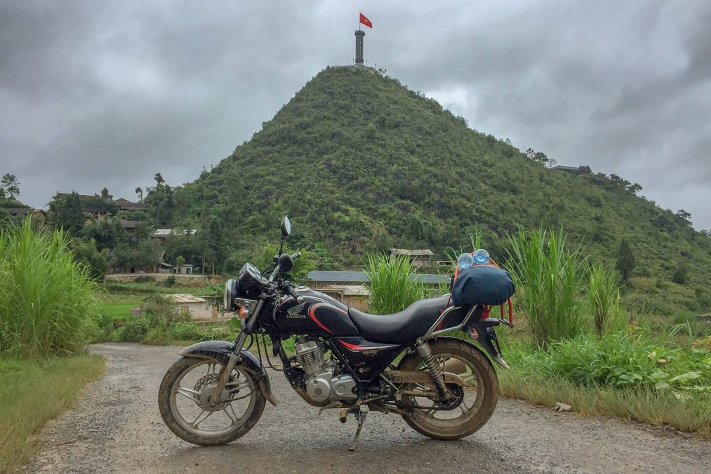 Honda Master parked beneath Lung Cu Flag Tower