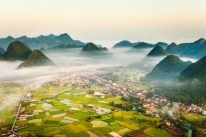 a view out over bac son valley with low lying cloud